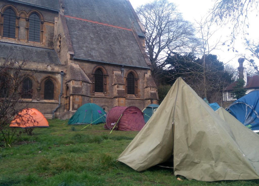 sea of tents outside St Giles Church in Cambridge