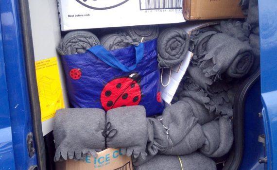 400 ponchos in a van
